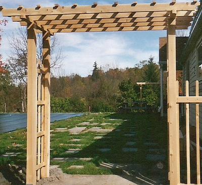 white cedar wood trellis arbor entrance to yard