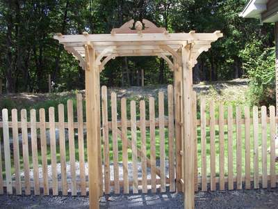 white cedar wood arbor trellis pergola spaced picket fence garden gate