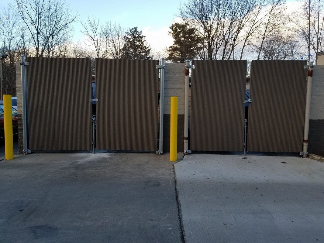 Chain Link. Custom Dumpster Gates. Painted Corrugated Sheet Metal Attached  To Commercial Galvanized Gate Frames.