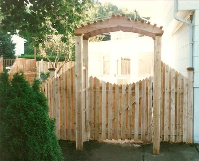 white cedar wood arbor arch pergola trellis board on board scalloped gate