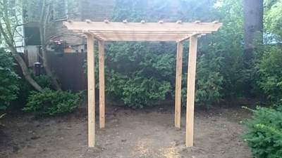 pergola trellis arbor vine flowers garden seating area white cedar wood